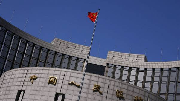 China central bank warns against illegal fund-raising by virtual currency, blockchain firms