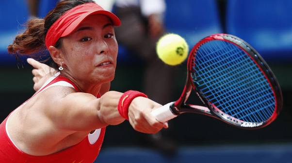 Wang Tokyo-bound after successful Asian tennis defence
