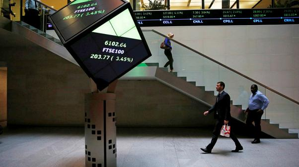 Oil stocks, miners prop FTSE 100 up as markets await Powell