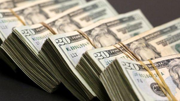 الدولار ينخفض مع تأكيد باول على سياسة رفع أسعار الفائدة