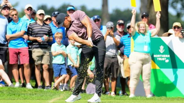 Koepka's late blitz catches Lovemark as Woods barely makes cut