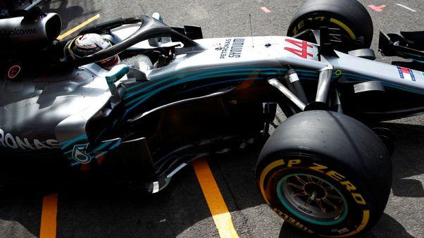 Hamilton on pole after rain shakes up Belgian grid