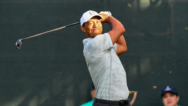 Bogey-free round no consolation for Woods