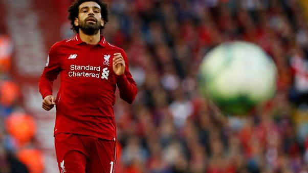 Salah strike sinks Brighton and sends Liverpool top