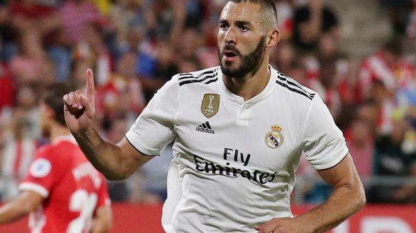 بنزيمة يسجل ثنائية وريال مدريد يواصل انطلاقته المثالية