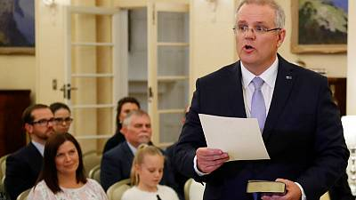 New Australian PM gets to work; government support plummets