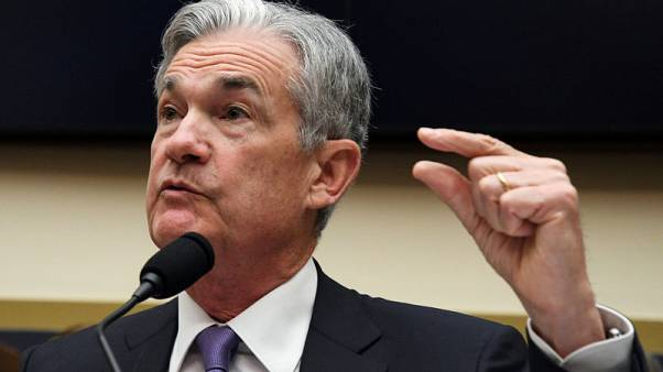 Powell sets Fed's course with data-based judgement