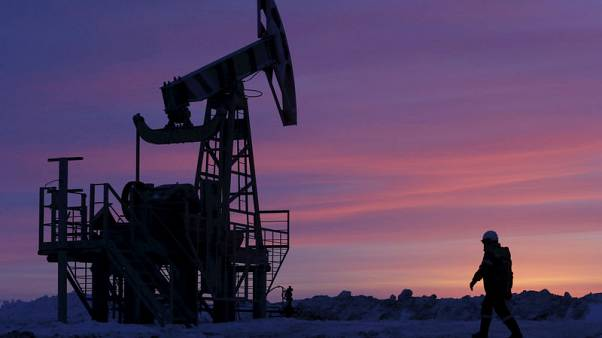 Oil stable as U.S./Sino trade row weighs, Iran sanctions cut supply outlook