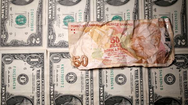 Turkish lira slides 3 percent as markets reopen, eyes on U.S. stand-off