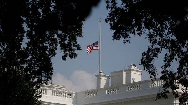 White House wobbles on U.S. flag after McCain death