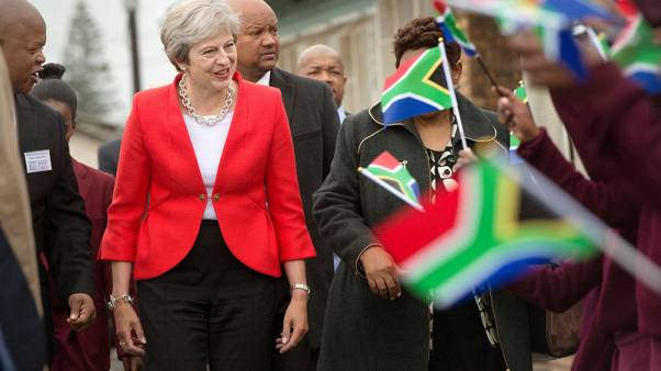 UK will use aid budget to boost trade in Africa - PM May to say