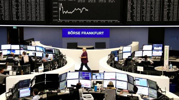 European shares reach two-week high after NAFTA deal; autos rally