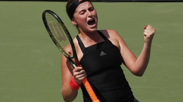 Ostapenko sweats out win as heat turned up at U.S. Open