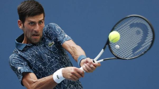 Djokovic battles through brutal heat to topple Fucsovics