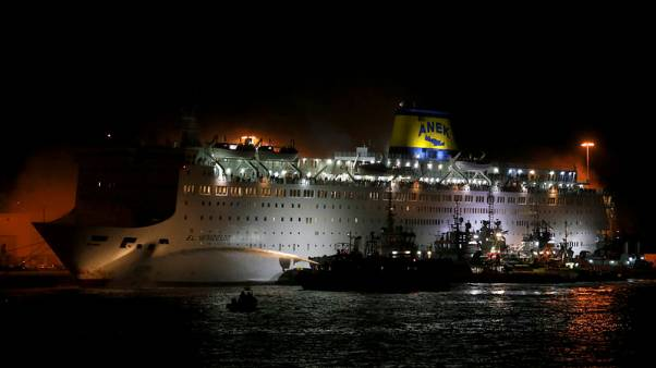 Greek passenger ferry docks at Piraeus after fire; no injuries reported