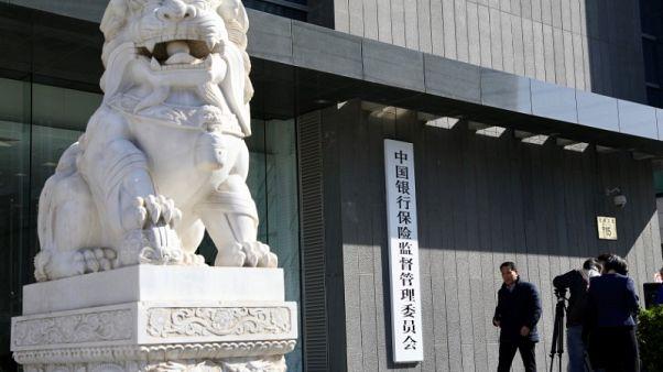 China bank regulator says will push forward with deleveraging