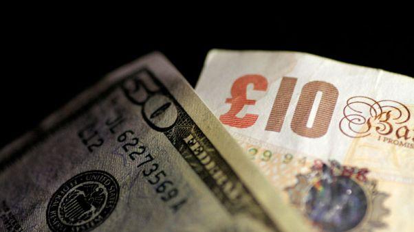 Sterling jumps 0.8 percent vs. dollar, stocks slip on Barnier remarks