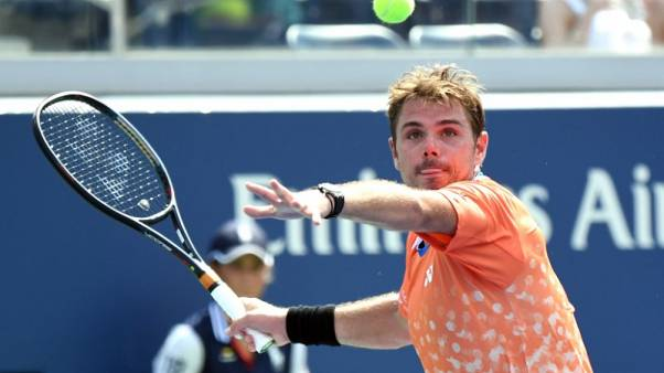 Wawrinka tames heat and young Frenchman at U.S. Open