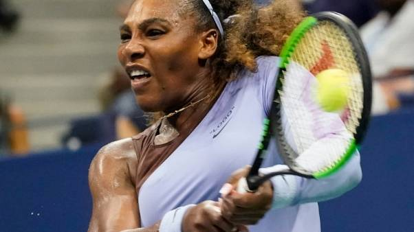 Serena sees off Witthoeft to set up Venus clash