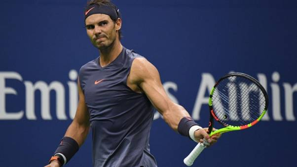 Nadal eases past Pospisil to reach U.S. Open third round