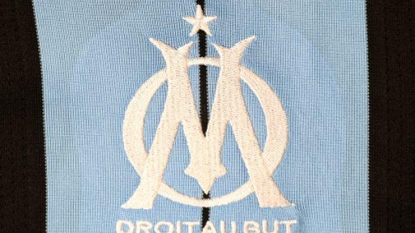 Logo de Marseille sur un maillot, le 6 août 2015