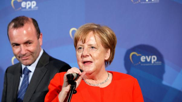 Merkel backs Bavarian ally as centre-right's EU Commission candidate - media