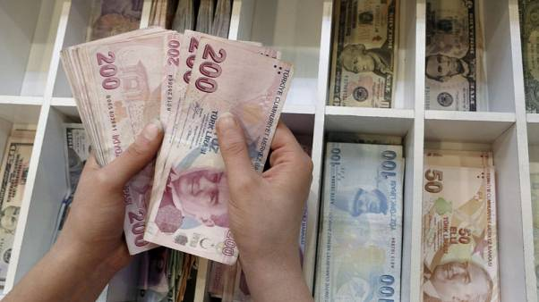 Turkish lira steady against dollar; eyes on central bank