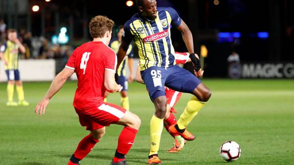 Olympic champ Bolt makes modest Mariners debut in friendly
