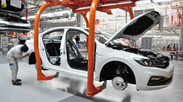 China says will curb 'haphazard and redundant' auto investment