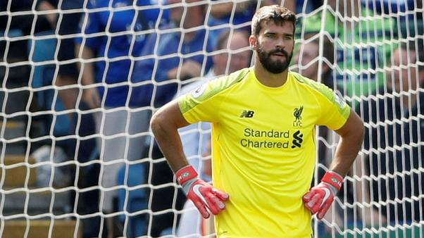 Liverpool survive Alisson howler to continue winning start