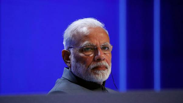 Indian postmen to turn bankers with Modi's new payments bank