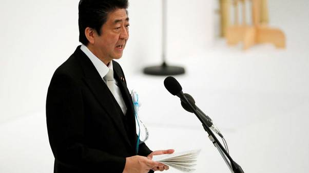 Japan PM Abe says relations with China back on 'normal track': paper