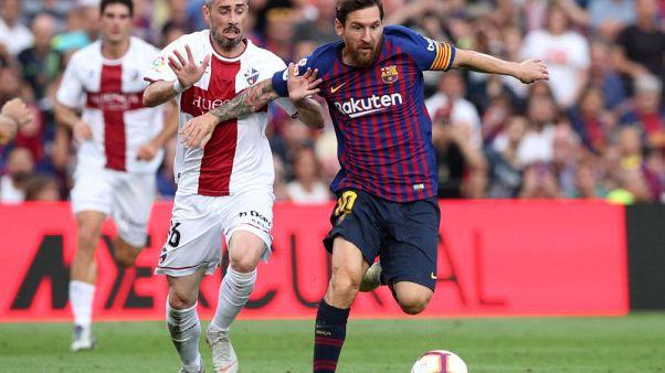 Messi and Suarez show no mercy as Barca humiliate Huesca