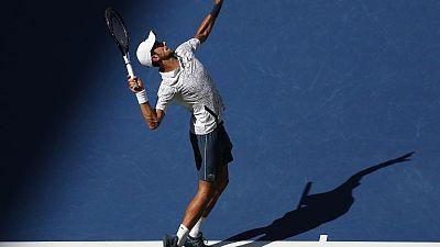Djokovic beats heat and Sousa to reach U.S. Open quarters
