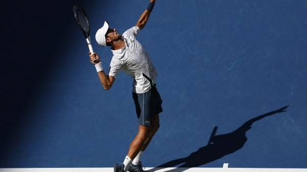 Djokovic beats heat and Sousa to reach U.S. Open quarters