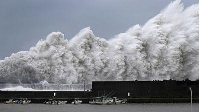 Typhoon slices through western Japan, killing at least six