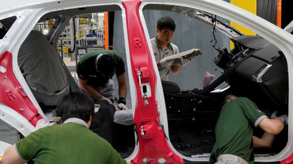 Automakers fret as China clamps down on capacity, seeks consolidation