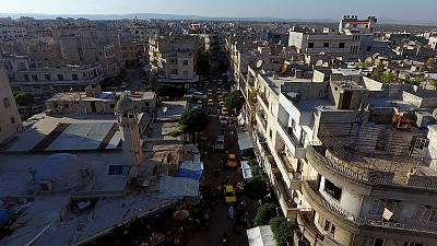 Syrian and Russian warplanes pound Idlib before talks