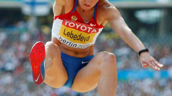 Two Russians lose world championships medals over doping