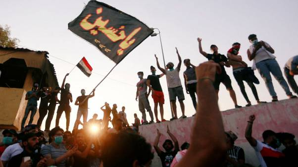 Iraqi protesters torch government building in Basra