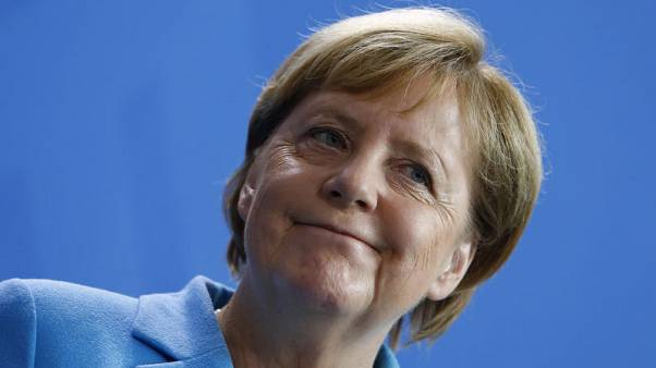 Merkel rebuffs conservative ally over far-right protests