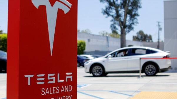 Tesla bond hits record low, stock slips as investor worry deepens