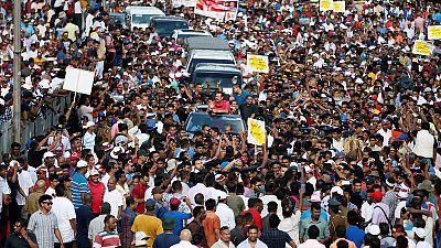 Sri Lanka opposition supporters block road over economic hardship, polls