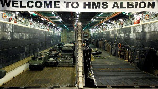 Exclusive - British Navy warship sails near South China Sea islands, angering Beijing