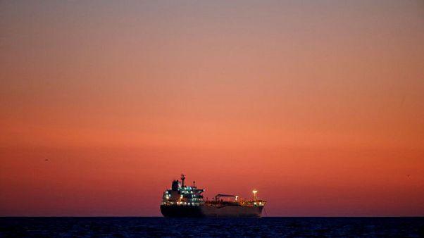 Oil prices climb as U.S. crude inventories drop