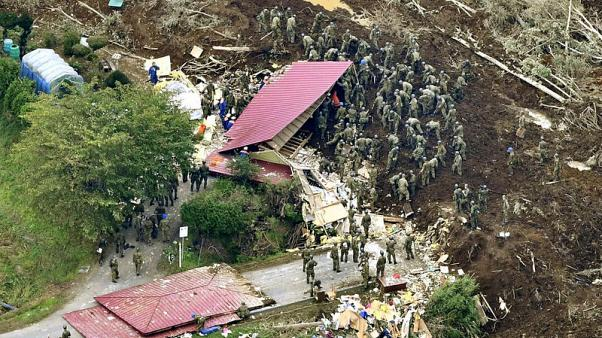 Rescuers with dogs search for survivors after deadly Hokkaido quake