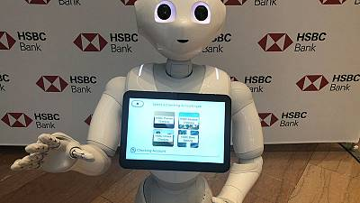 Banks turn to espressos, dancing robots to help keep U.S. branches alive