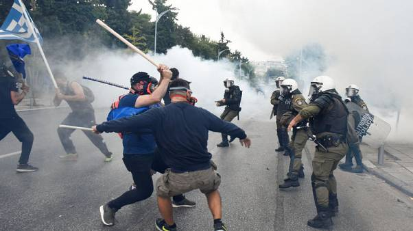 Greek police fire teargas at Macedonia protesters