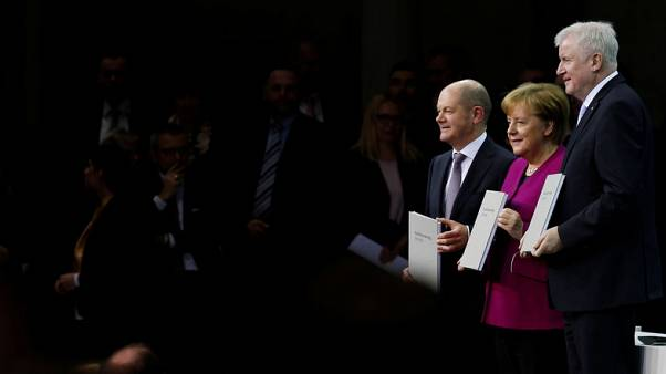Support for Merkel's coalition parties hits record low - poll