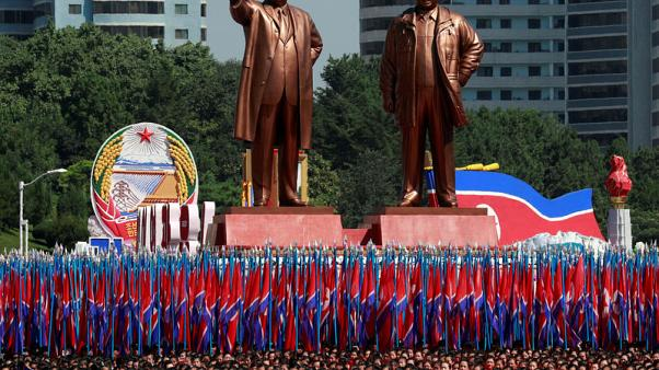 No long-range missiles, North Korea military parade features floats and flowers